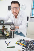 Stressed computer engineer showing broken fan — Foto de Stock