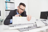Technician fixing keyboard with screw driver — Stock Photo
