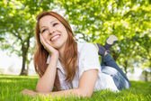 Pretty redhead relaxing in the park  — Stock Photo