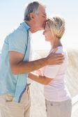 Happy senior man giving his partner a kiss on forehead — Stock fotografie