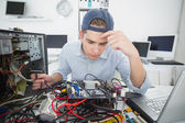 Computer engineer working on broken console — Stock fotografie
