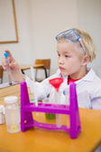 Pupil dressed up as scientist in classroom — Stock Photo