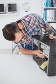 Computer engineer working on broken console — Zdjęcie stockowe