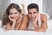 Portrait of romantic couple in bed — Stock Photo