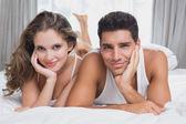 Portrait of romantic couple in bed — Стоковое фото