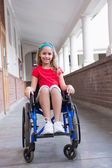 Cute disabled pupil in hall — Stock Photo