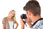 Man taking photo of his girlfriend sticking her tongue out — Stock Photo