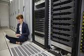 Technician sitting on floor — Stock Photo