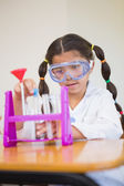Pupil dressed up as scientist in classroom — Stock fotografie