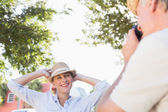 Happy senior woman posing for her partner taking photo — Stock Photo