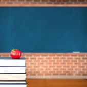 Red apple on pile of books in classroom — Stock Photo