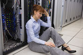 Stressed technician sitting on floor — Stock Photo