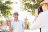 Happy senior man posing for his partner taking photo — Stock Photo