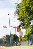 Pretty tennis player hitting ball — Stock Photo