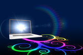 Laptop with colourful spiral design — Stock Photo