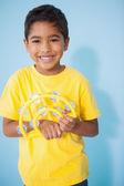 Little boy playing the tambourine — Stock Photo