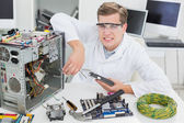 Angry computer engineer working — Stock Photo