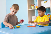 Little boys playing with modelling clay — Foto Stock