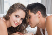 Romantic couple in bed at home — Stock Photo