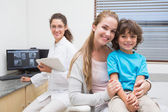Pediatric dentist smiling at camera — Foto Stock