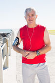 Fit mature man smiling at camera on the pier — Foto Stock