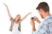 Man taking photo of his pretty girlfriend — Stock Photo