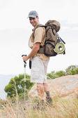 Portrait of hiking man walking on mountain terrain — Stock Photo