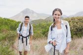Hiking couple walking on countryside landscape — Stock Photo