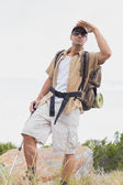 Hiking man walking on mountain terrain — Stock Photo