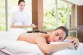 Beautiful woman receiving stone massage at health farm — Stock Photo