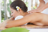 Beautiful brunette enjoying massage — Stock Photo