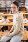 Pretty teacher at top of classroom — Stock Photo