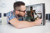 Computer engineer working on broken console — Stockfoto
