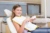 Girl sitting in dentists chair — Stock Photo