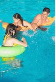 People playing in the swimming pool — Foto de Stock