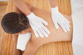 Beautiful brunette enjoying back massage — Stock Photo