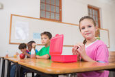 Pupils having their lunch in classroom — Stock Photo