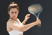 Portrait of confident female tennis player with racquet — Stock Photo