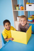Little boys reading at desk in classroom — Stock Photo
