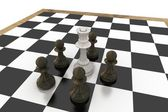 White queen surrounded by black pawns — Stock Photo