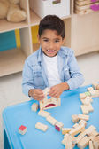 Little boy playing with building blocks — Stock Photo