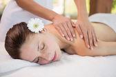 Attractive woman receiving shoulder massage at spa center — Foto de Stock