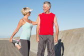 Active senior couple stretching before a jog — Stock Photo
