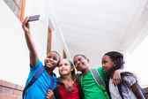 Pupils taking a selfie in the corridor — Stock Photo