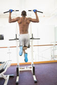 Body builder doing pull ups at gym — Stock Photo