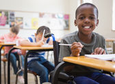 Disabled pupil smiling in classroom — Stock Photo