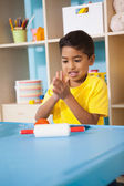 Little boy playing with modelling clay — Foto Stock