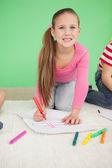 Cute little schoolgirl drawing — Stock Photo