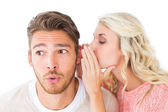 Attractive blonde whispering secret to boyfriend — Stock Photo
