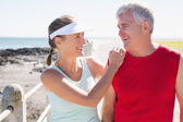 Fit mature couple warming up together on the pier — Stock Photo